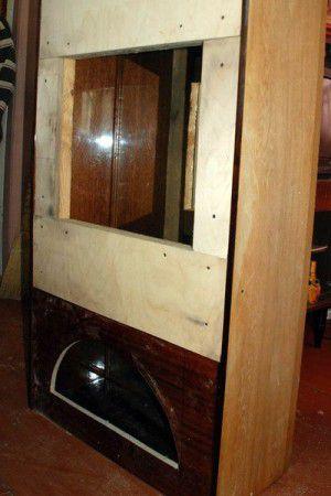Zashivaem-fasad-kamina-faneroy-300x450 Фальшкамин для квартиры своими руками фото пошаговой инструкции
