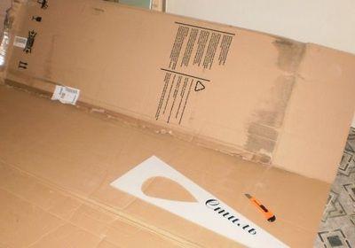 Обыкновенная упаковочная коробка от холодильника